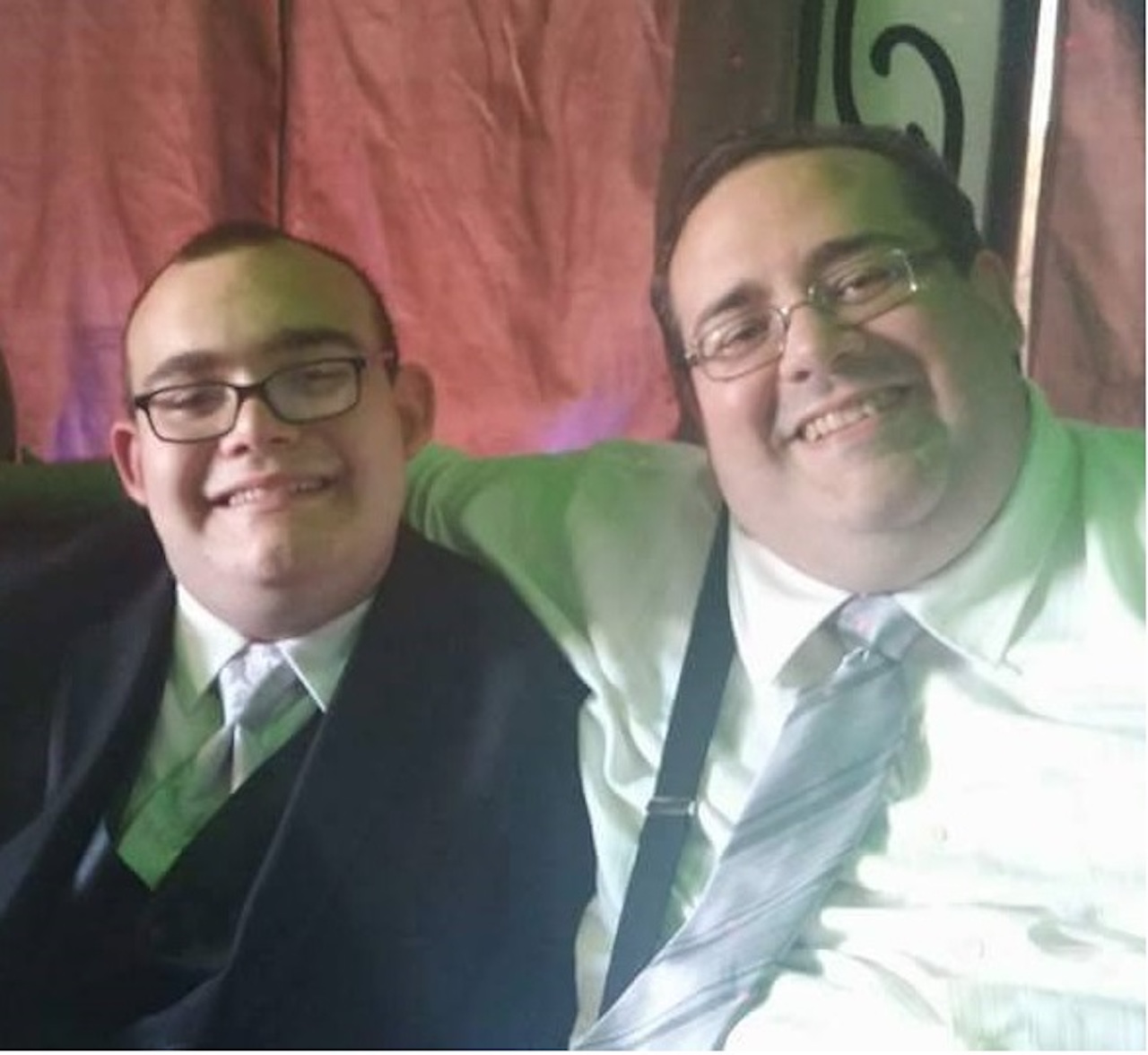dad and son with autism at the wedding