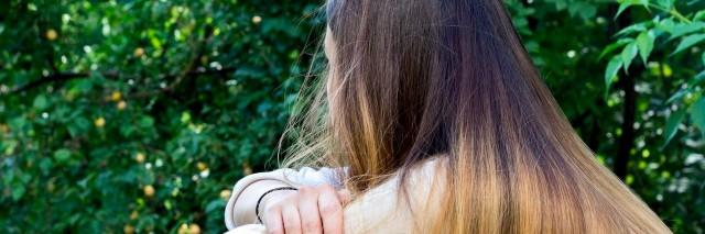 teenage girl sitting alone