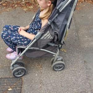 Rachel's daughter in a stroller