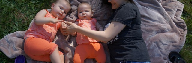Stephanie with her two daughters outside.