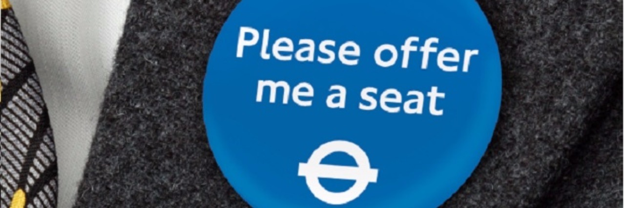 """TfL Badge saying """"Please offer me a seat"""""""