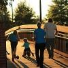 Family walking across a bridge.