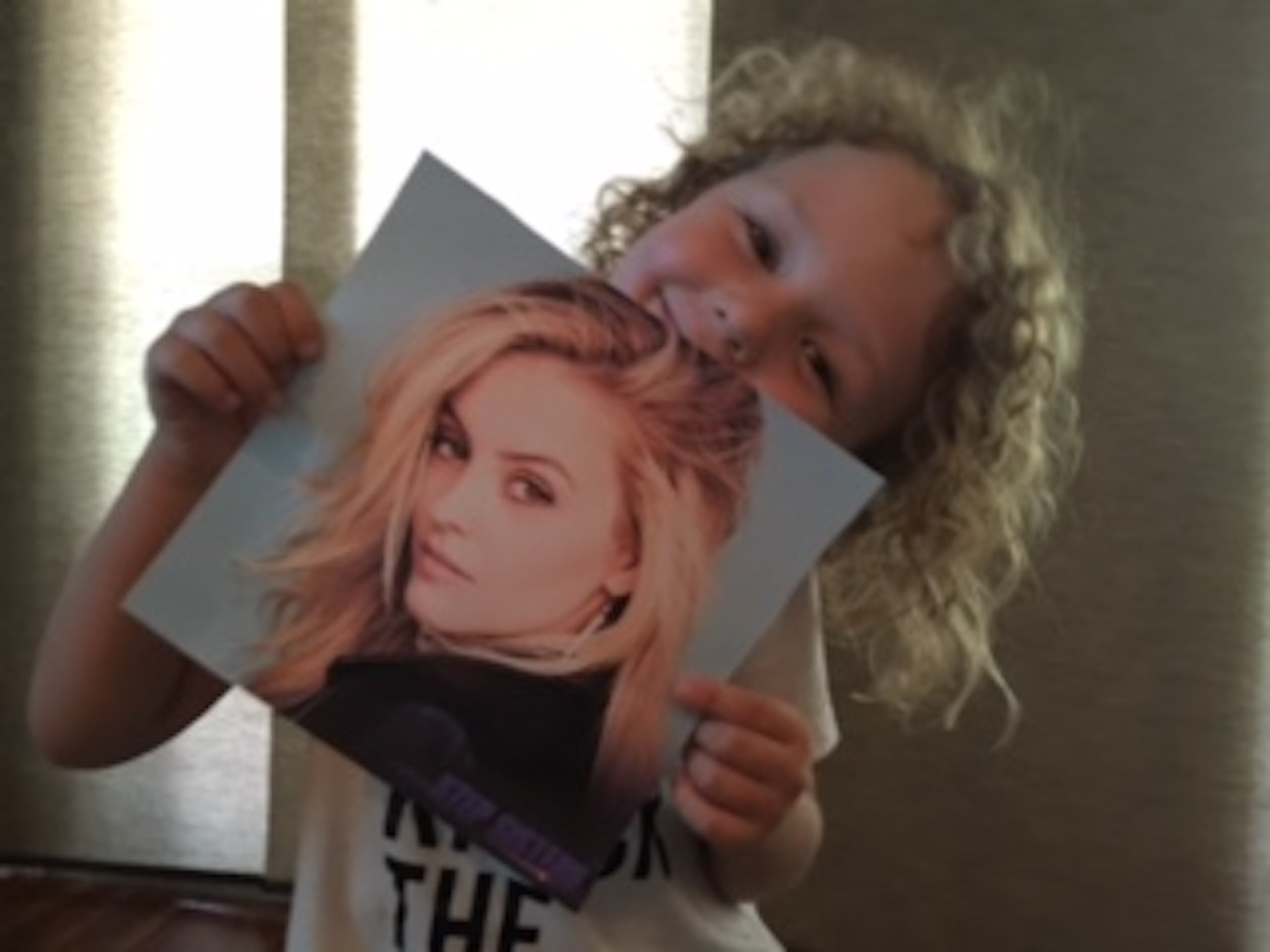little boy with apraxia holding photo of gage golightly