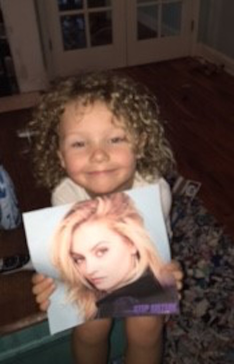 little boy with apraxia holding picture of gage golightly