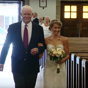 bride walks down the aisle with man her dad donated his heart to