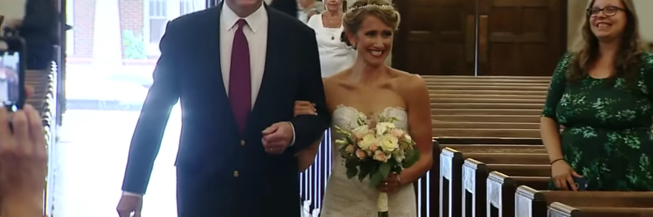 bride walking down aisle with man who got her father's donated heart