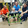 Home Depot team with Silus in his walker. Credit: Fox News
