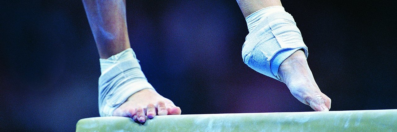 gymnast on a balance beam
