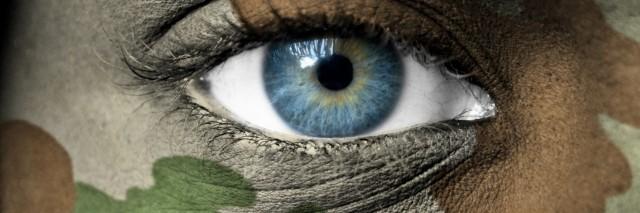woman's eye with camoflouge around it