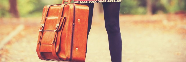 girl holding a suitcase