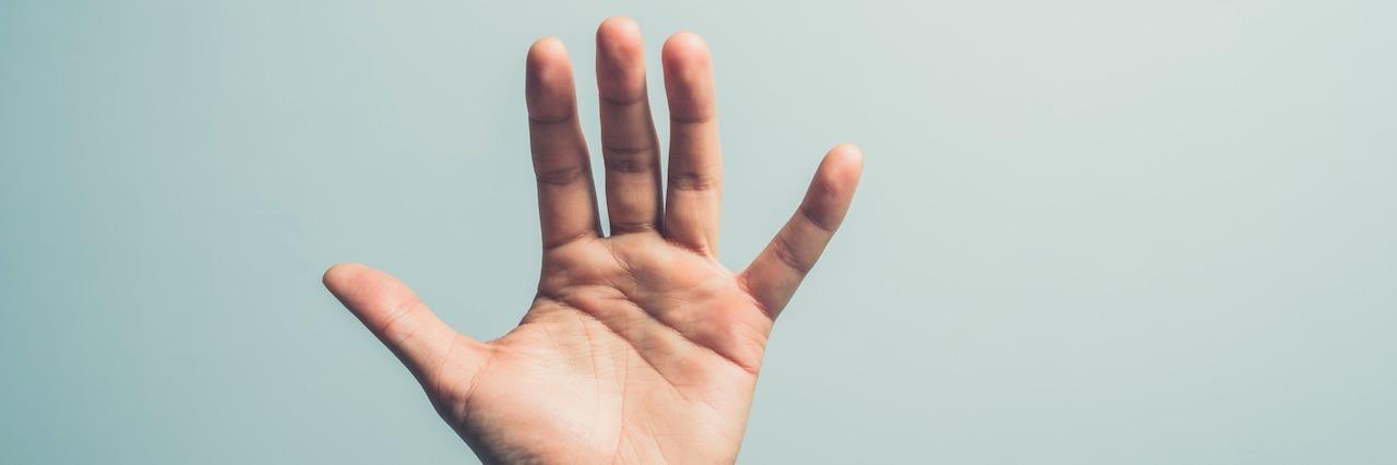 a hand reaching up