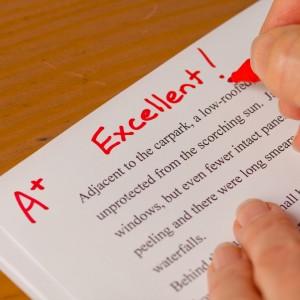 Teacher giving an A grade.