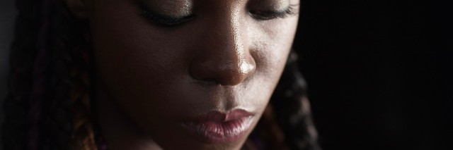 close up of a woman with dreads
