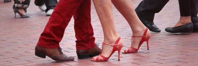 the feet of two people dancing together