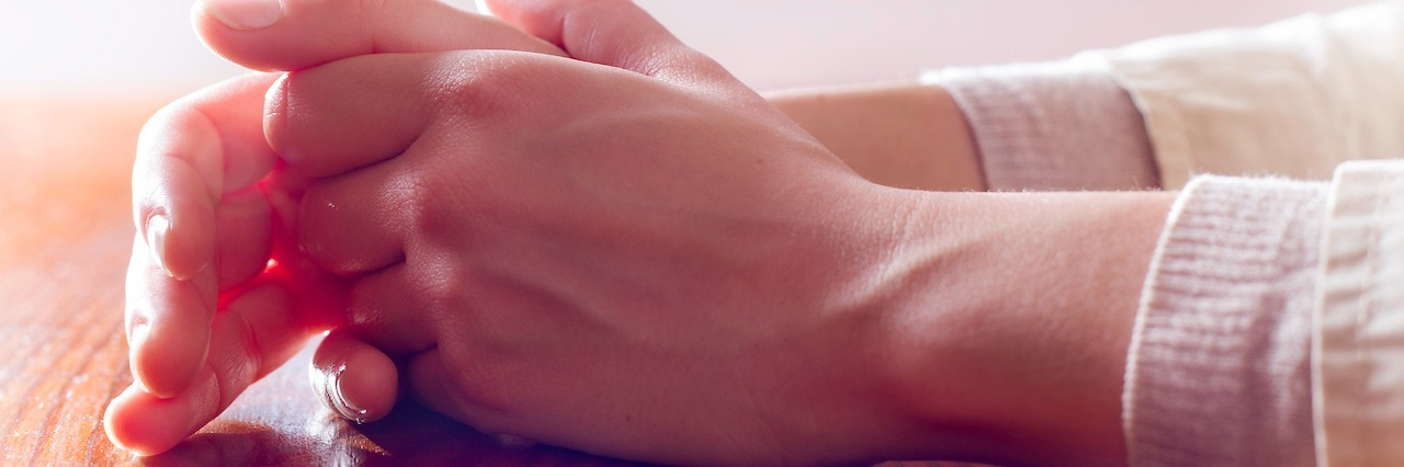 Close-up of woman hands in reflexive and concern position