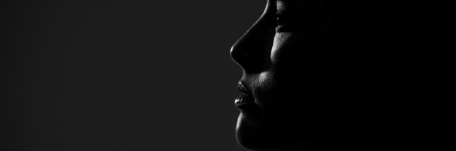 Abstract silhouette of young pretty woman looking away. Profile view.