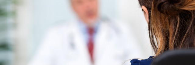 Doctor talking to a patient in his office