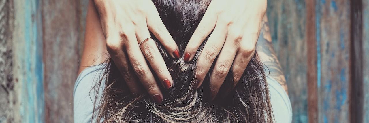 woman running her fingers through her hair