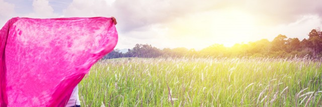 Woman with natural prairie sky, Khao Yai National Park.