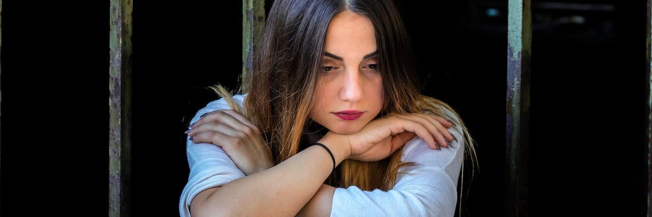 An unhappy woman sitting