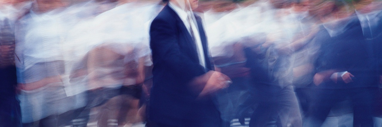 Business people crossing at the crosswalk, blurred motion