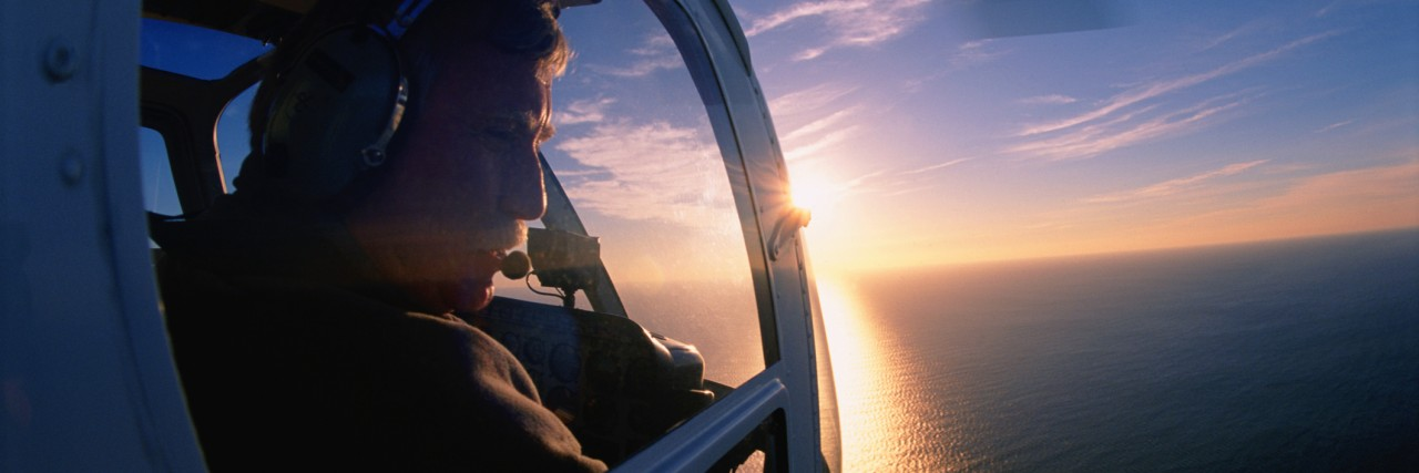 Helicopter pilot looking out of window