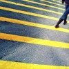 woman walk on asphalt floor with yellow lines