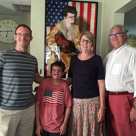 Evan Hildebrandt, Logan Brinson and Sue and Lee Schaefer pose with Logan's portrait.