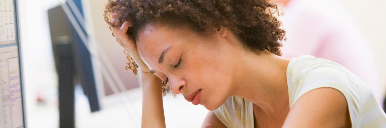 woman resting head on arm
