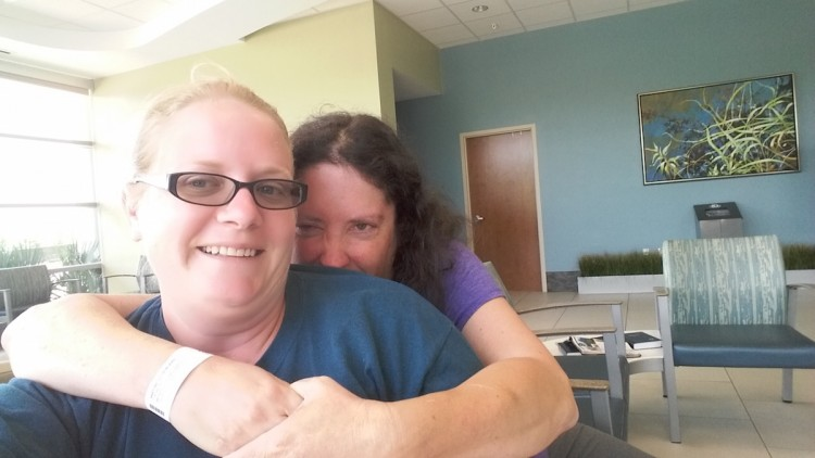 woman hugging her friend in selfie photo at hospital