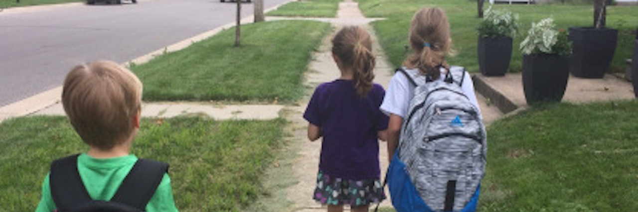 three kids walking to school