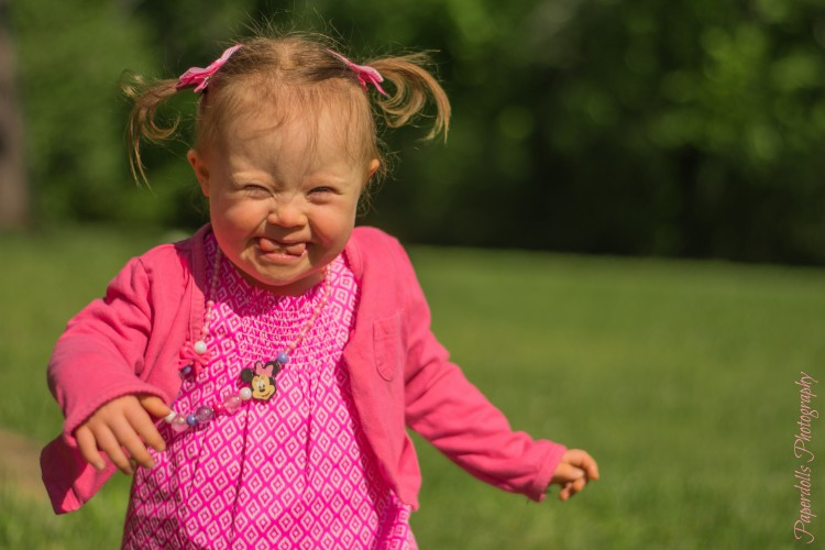 Photo of happy little girl walking