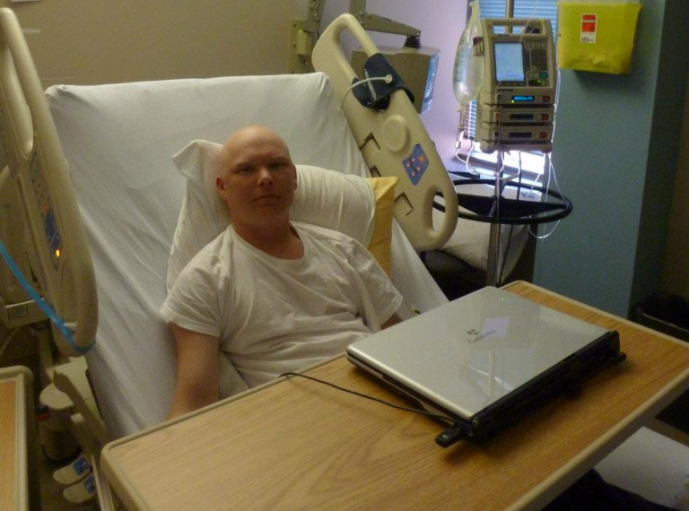 The author in a hospital bed