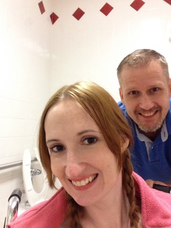 man and woman in the target family restroom