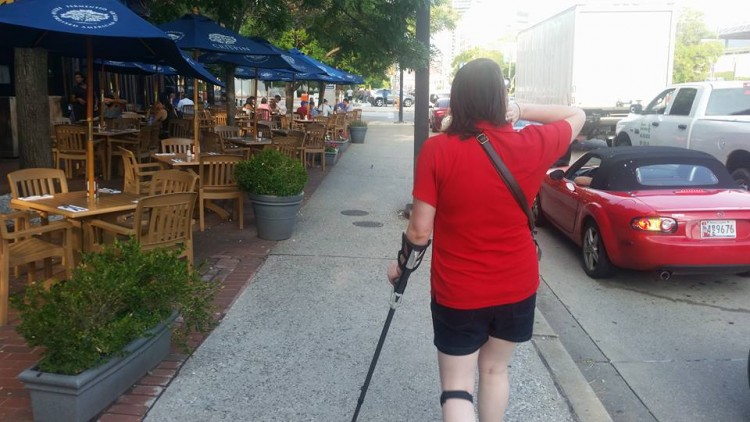 woman walking down street with a cane