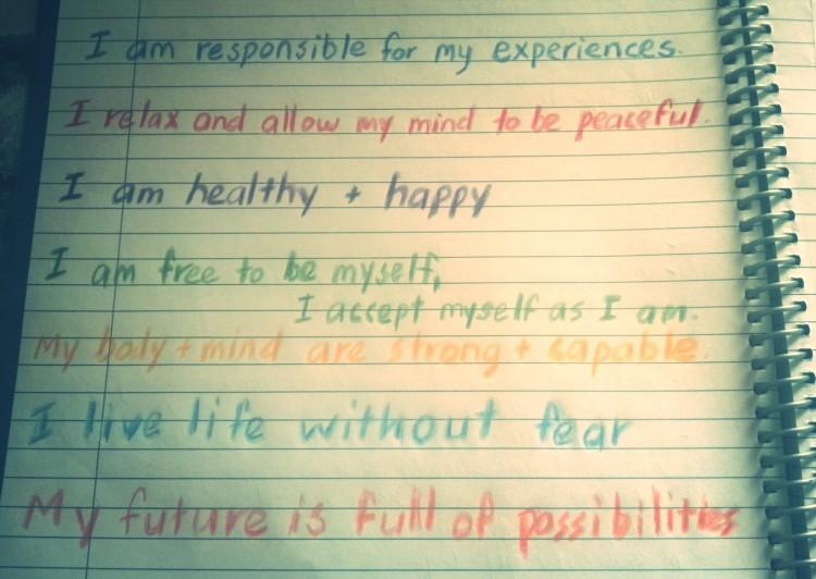 positive affirmations written on notebook