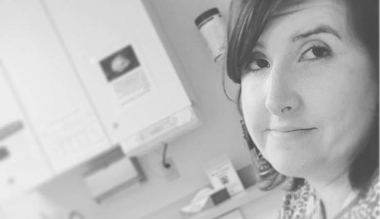 woman in black and white photo in medical office