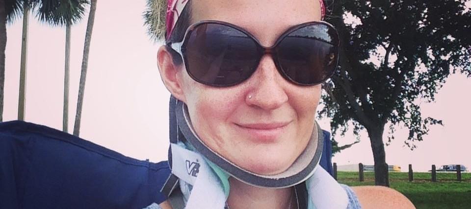 woman wearing a neck brace and sunglasses