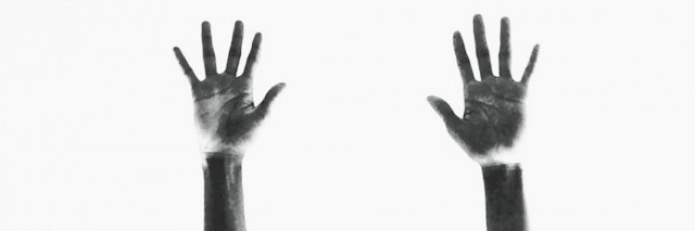 two hands reaching up
