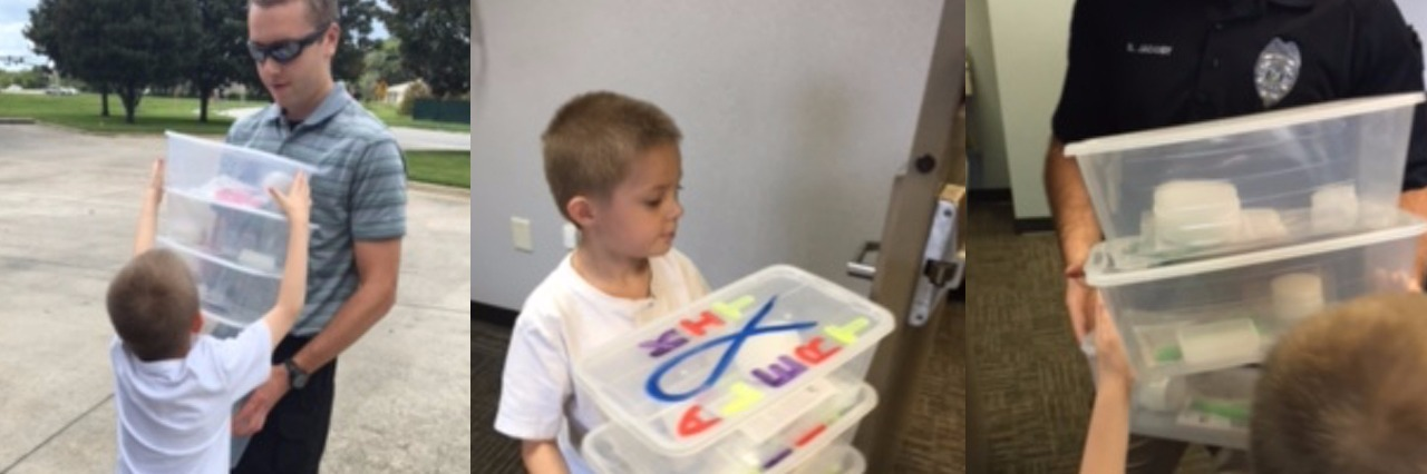Stephanie Cooper's son with ALERT autism boxes