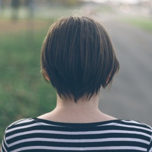 woman staring at the road ahead