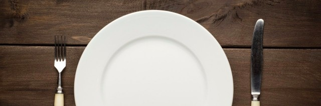 plate and silverware on a wooden table