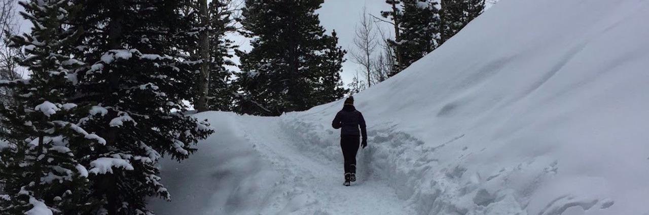 woman hiking in the Rockies