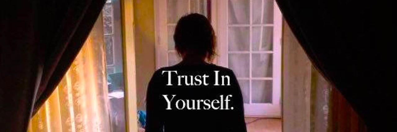 an image of a woman and her dog standing in a doorway with text that says trust in yourself trust the process
