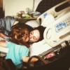 woman lying in hospital bed kissing her toddler daughter