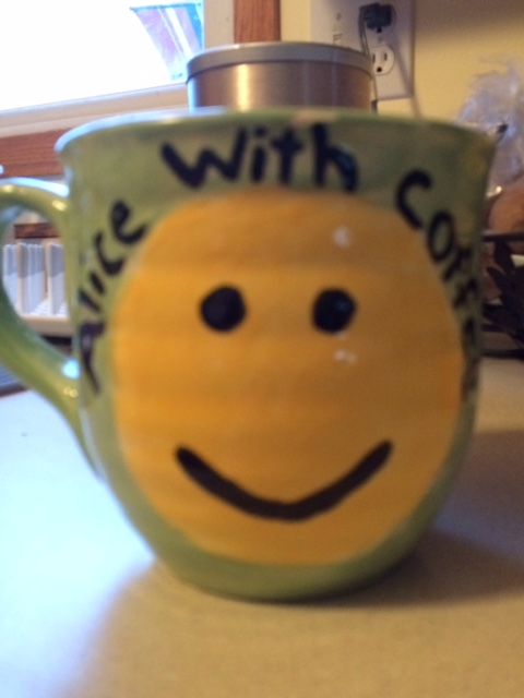 coffee mug with yellow smiley face