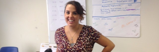 teacher standing in classroom in front of board