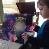 The author's son looking at a Coldplay book