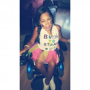precious wearing her 'born to stand out' shirt