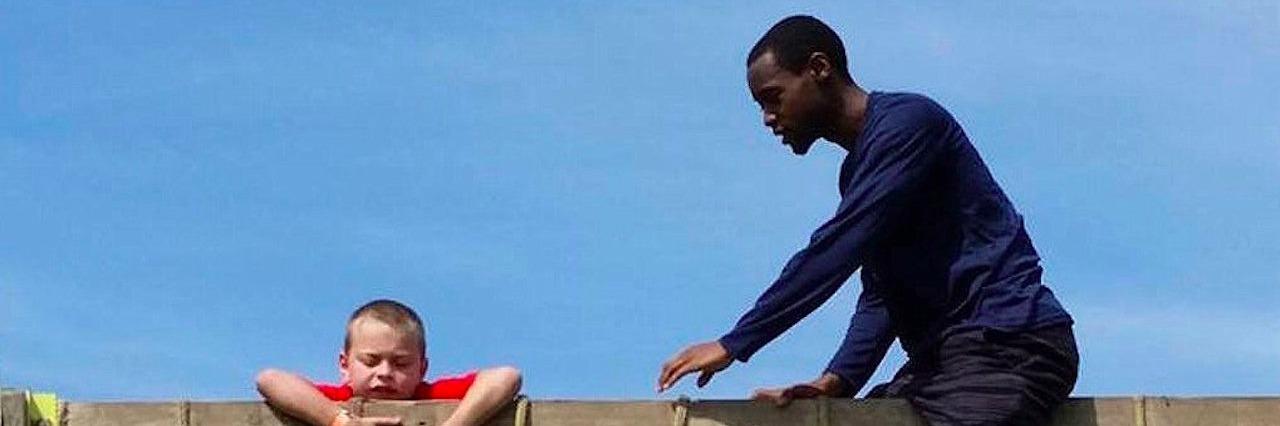 A member of Lincoln University's men's basketball team helping Joy Gilzow's son, Blaze